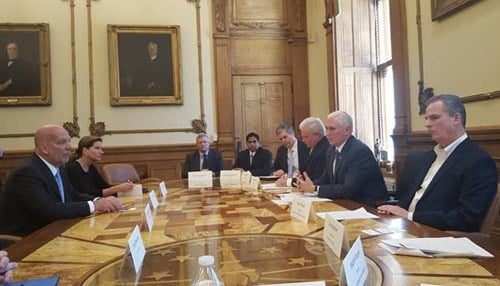 UTC Climate, Controls & Security President Robert McDonough (left) talked with Governor Pence Wednesday.