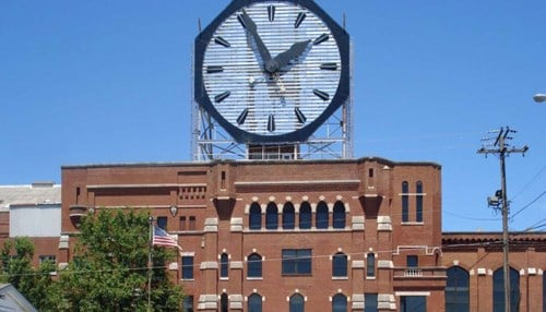 The former Colgate-Palmolive factory, featuring the iconic clock, would be redeveloped under the plan.