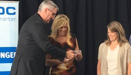 Lieutenant Governor Eric Holcomb (left) presented an award to Dana-based Brooke's Candy Co. co-owners Brooke Schmidt and Dana Vicars.
