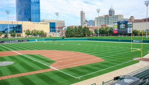 Victory Field's football field configuration runs north-to-south, parallel to the third base line.