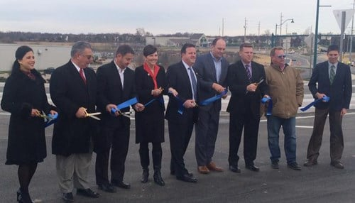 (Image courtesy of INDOT) State, city and business officials gathered in Fishers Wednesday for the ribbon cutting at the new I-69 and 106th Street interchange.