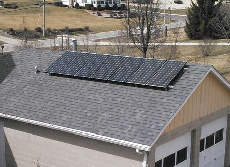 Two new solar panels are added to the Oldenburg convent's farm garage. Photo by Lohrum Elecrical