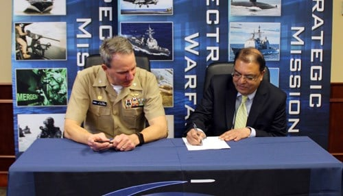 """(Image courtesy of NSWC Crane.) The agreement was signed this week by NSWC Crane Commanding Officer Captain James """"JT"""" Elder and IU School of Informatics and Computing Dean Raj Acharya."""
