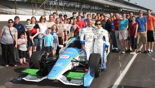 Pittenger (center) with her family and Mario Andretti after taking a two-seater ride at Indianapolis Motor Speedway in 2014. (photo courtesy IMS)