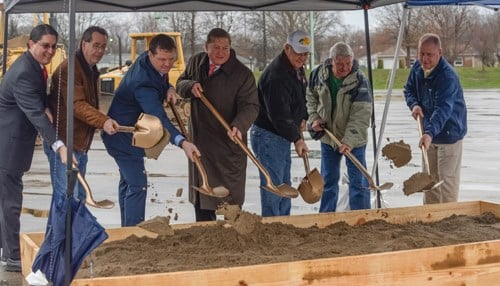 Officials including CEO Dan Lee (pictured center) broke ground Tuesday on the RV park project.
