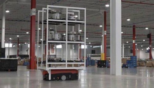 An AIV is platform on wheels;  a rack on top moves parts throughout the production floor.