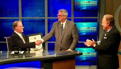 Holcomb surprised Benner with the award during a taping of Inside INdiana Business Television.