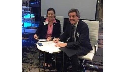 IHIF CEO Kristin Jones is pictured on the left with SLA CEO Scott Johnstone.