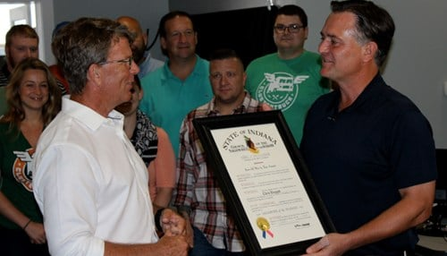 (Image courtesy of the office of Congressman Luke Messer) Chris Baggott (left) is presented the Sagamore of the Wabash by Congressman Luke Messer (right).