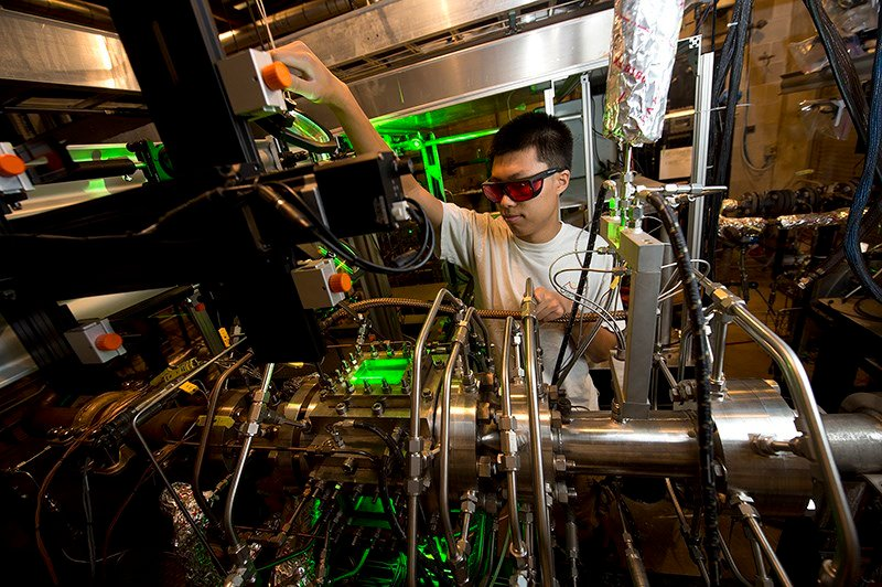 College of Engineering student Robert Zheng adjusts the path of a laser beam in a Zucrow Lab research and testing bay. Photo Courtesy of Purdue University.