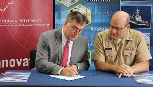 IU Vice President for Research Fred Cate (left) and NSWC Crane commanding officer Capt. Mark Oesterreich signed the agreement. (photo courtesy Indiana University)