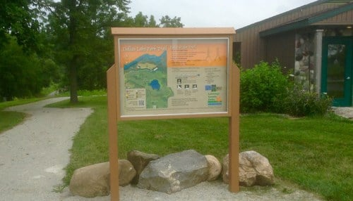 (Image of a Dallas Lake Park trailhead courtesy of LaGrange County Parks.)