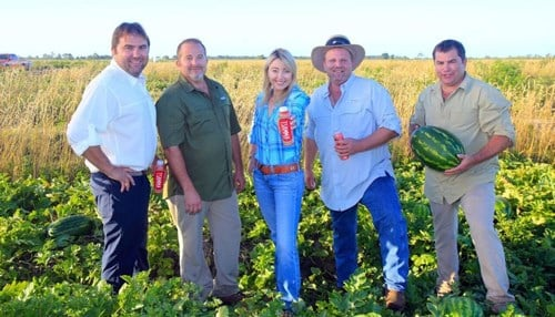 Sarah Frey (center) and her four brothers (from left: John, Harley, Ted and Leonard Frey) operate farms and facilities in seven states.