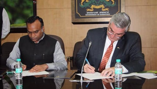 (Image of Karnataka Minister for Information, Technology, Biotechnology and Tourism Priyank Kharge and Governor Eric Holcomb courtesy of the Indiana Economic Development Corp.)