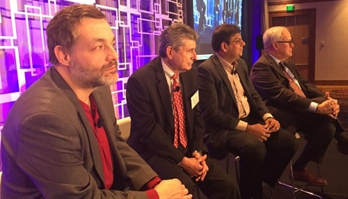 "Lechleiter (pictured far right) was part of a panel on ""Creating Collisions by Crossing Sector Lines"" at the summit."