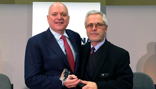 Outgoing Board Chairman Ron Christian (right) passed the ceremonial gavel to Baldwin after his election. (photo courtesy Indiana Chamber)