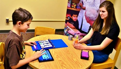 Autistic children can use the app to help them communicate. (photo courtesy SPEAK MODalities)