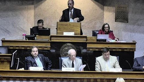State Senator Greg Walker (pictured at podium) serves as chair of the Senate Elections Committee.