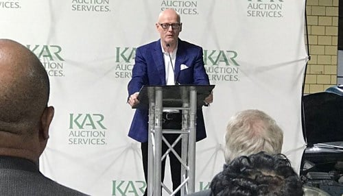 Jim Hallett (pictured at podium) is CEO of KAR Auction Services.