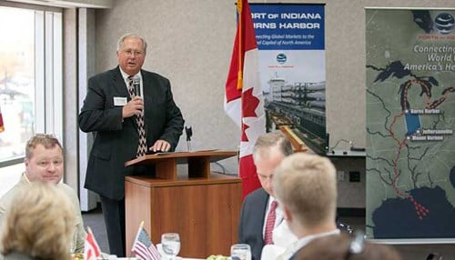 Rich Cooper, pictured at the podium, is CEO of the Ports of Indiana.