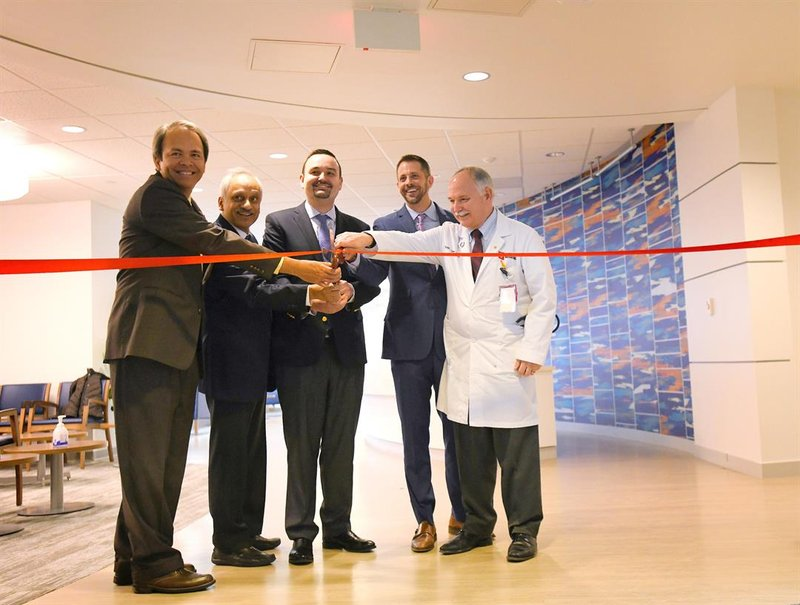 IU Precision Genomics leaders cut the ribbon to open a new clinic inside the Simon Cancer Center in Indianapolis.