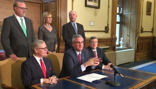 Top Row Left-to-Right: Senate President Pro Tempore David Long, Lieutenant Governor Suzanne Crouch, House Speaker Brian Bosma, Senator Ron Alting, Governor Eric Holcomb, Representative Ben Smaltz.