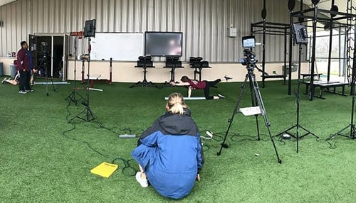Skyepack content development team members film instructional videos for a strength training course at Texas A&M. (photo courtesy Skyepack)