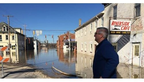 (Image of Governor Eric Holcomb touring flooded areas courtesy of the state of Indiana.)