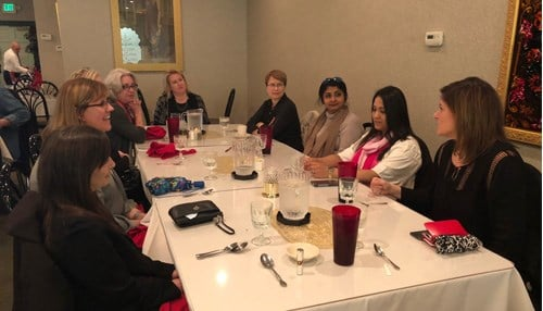 "Cassidy (right) and HBA Executive Advisory Council member Rupal Thanawala (third from right) lead a HBA luncheon on ""The Power of Networking."""