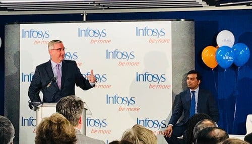 Governor Eric Holcomb (pictured at podium) helped cut the ribbon on the Infosys technology hub at One America Tower in March of 2018 in downtown Indianapolis.