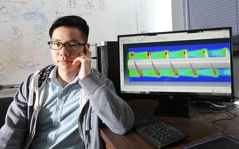 Yu Liu, works on computer simulation of biomass particle movement through a screw conveyor (Photo courtesy of Purdue University)