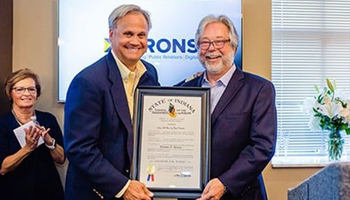 State Sen. Jim Merritt presented Tom Hirons (right) with the Sagamore of the Wabash.