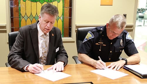 Indiana Tech President Karl Einolf and ISP Superintendent Doug Carter signed the agreement. (photo courtesy Indiana Tech)