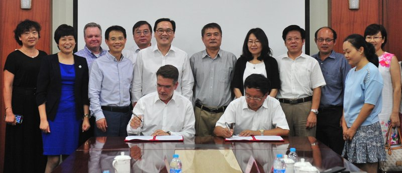 Dow AgroSciences leaders and the Chinese delegation sign the agreement.