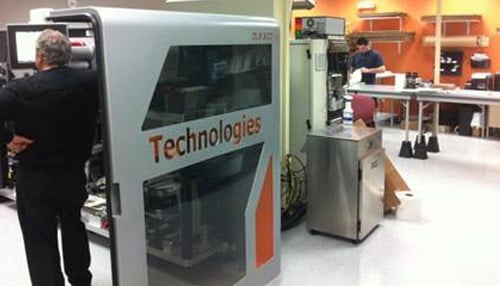 """DuraMark, whose printing equipment is pictured here, was named one of the """"Companies to Watch"""" by the state in 2014."""