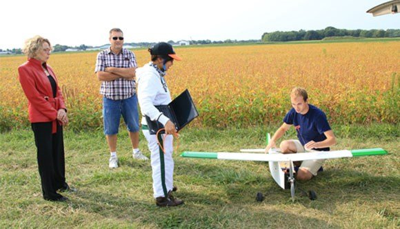 A Purdue student prepares a UAS for flight at the university's Agronomy Center for Research and Education.