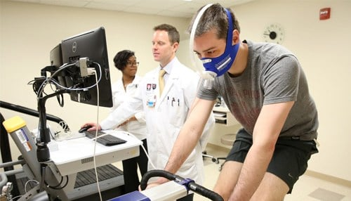 Sports Cardiologist Michael Emery (pictured at controls of the machine) is the director of the new center.