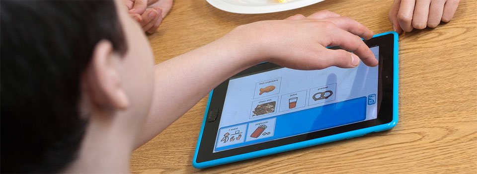 "The child drags and drops pictures to a sentence strip, and the iPad ""speaks"" the sentence."
