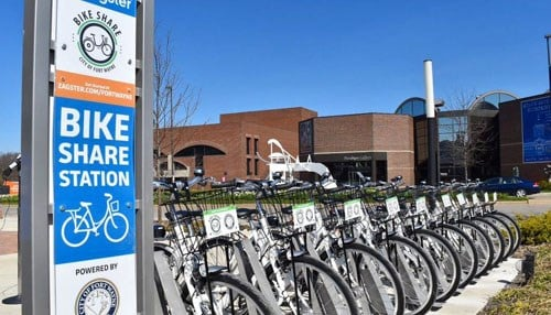 The city's bike share program includes 25 bikes at five downtown locations.