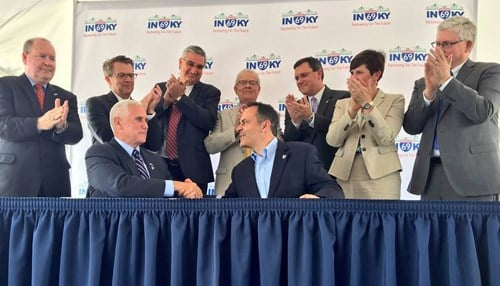 Governor Mike Pence and Governor Matt Bevin (pictured left-to-right in foreground) signed a memorandum of understanding on behalf of their respective states along with state and local leaders.