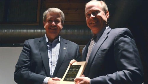ISDA Director Ted McKinney (left) presents the AgriVision Award to Bret Marsh.