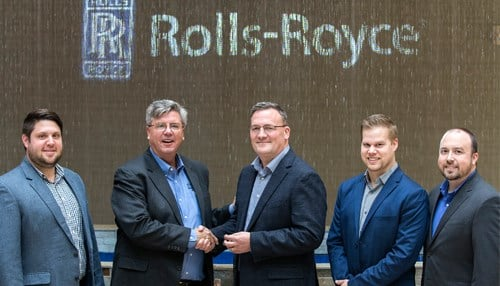 Purdue Research Park President Dan Hasler hands the keys to David Waggoner of Rolls-Royce. (photo courtesy Purdue University)