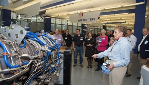 Rolls-Royce Heritage Trust Allison Branch volunteer and retiree Betsy Spencer shows visitors an AE 3007 jet engine on display at the new, reopened museum. (photo courtesy Rolls-Royce)