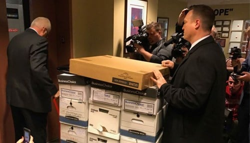 Investigators took boxes of city documents from the building commissioner's office in January. (photo courtesy WTHR-TV)
