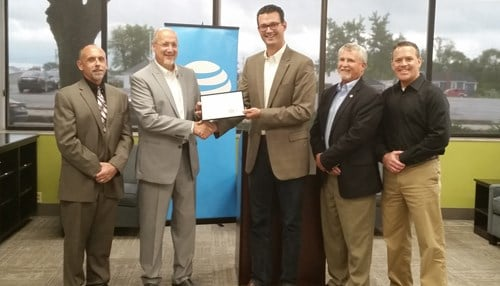 AT&T Indiana officials Thursday presented the certification to Inventrek.