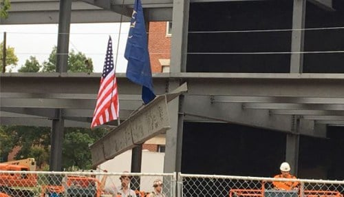 Crews raising the final steel beam onto the frame of the new facility. (photo courtesy Franklin College)