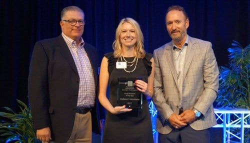 Chamber Interim CEO Anne Bono (center) presented the award to Indiana Limestone COO Duffe Elkins (left) and CEO Tom Quigley.