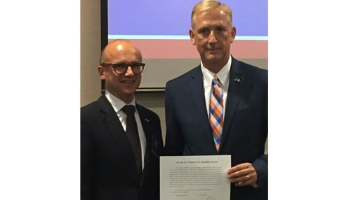 Consul General of France in Chicago Guillaume Lacroix (left) inducted Bauer into the diplomatic role Tuesday.