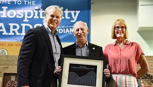 Crowther (center) received the Will Koch Indiana Tourism Leadership Award last August.