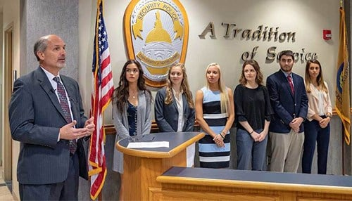 Prosecuting Attorney Kenneth Cotter held a swearing in ceremony Friday for six new student interns. (photo courtesy University of Notre Dame)